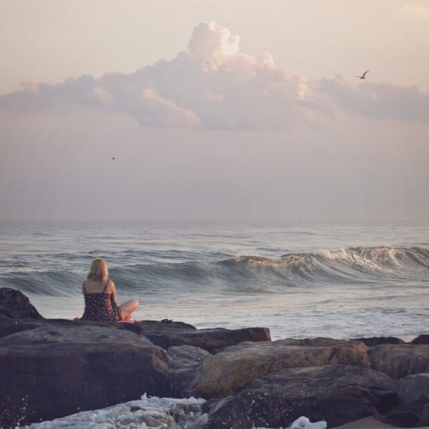 Canva - Woman Contemplating by the Beach